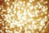 stock photo of twinkle  - Golden background with natural bokeh defocused sparkling lights - JPG
