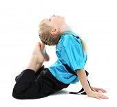 foto of karate-do  - Little girl in kimono doing exercises isolated on white - JPG
