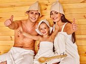 stock photo of sauna  - Group people in hat  relaxing at sauna - JPG