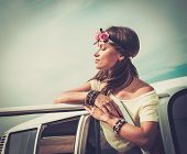 image of hippy  - Hippie girl in a van on a road trip - JPG