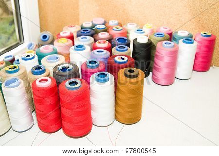 Many Spools Of Thread Is On The Table