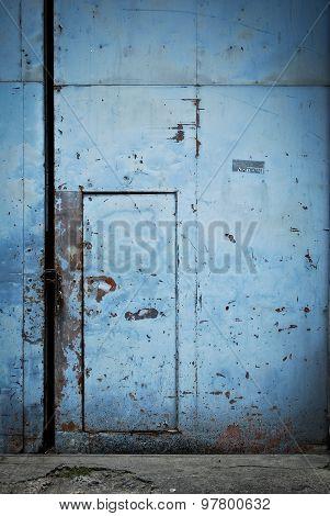 Blue Tin Metal Door on a Gate