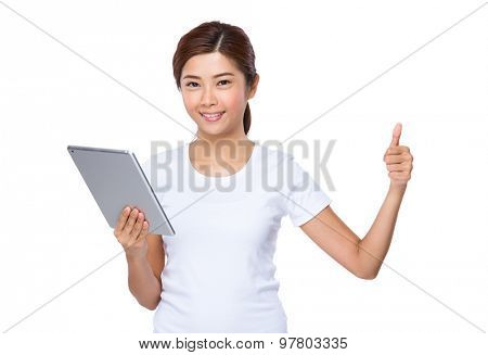 Asian woman use of tablet pc and thumb up