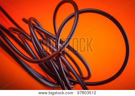 Abstract  flexible audio cable on orange , great music background