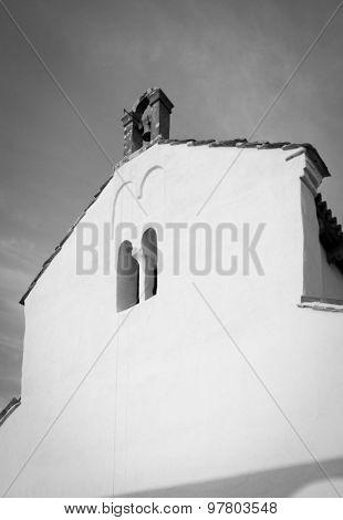 Small Mediterranean Catholic church in Croatia, black and white toned photo