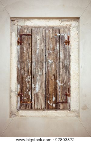 Old grunge wooden window on abandoned house