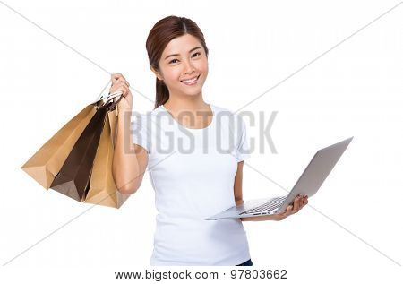 Asian woman using laptop computer for online shopping
