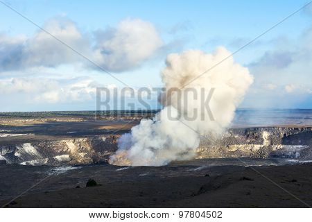 Kilauea volcano exploding after an earthquake spills rocks into the molten lava of the active vent within the caldera.V