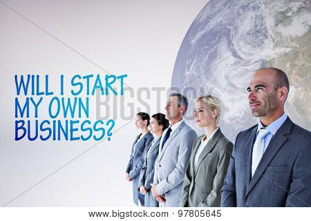 Business people standing in a row against grey background