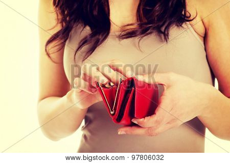 Young worried woman with an empty wallet.
