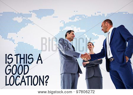 Business colleagues greeting each other against blue world map on white background