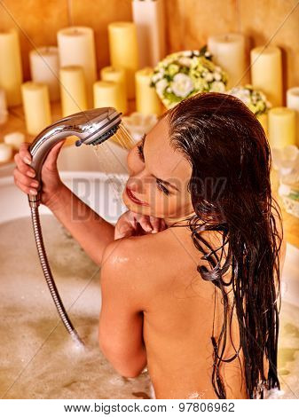 Young woman take shower in bubble  bath.