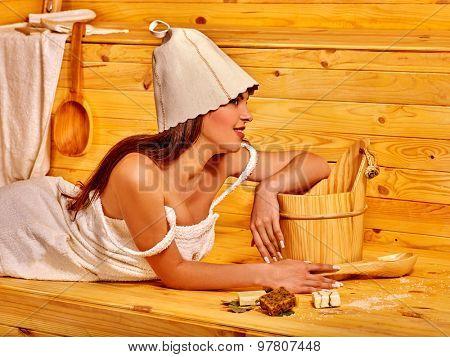 Woman wearing  in cap for sauna relaxing indoor.