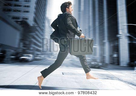Businessman jumping against new york street