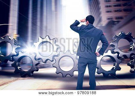 Businessman standing hand on hip against new york street