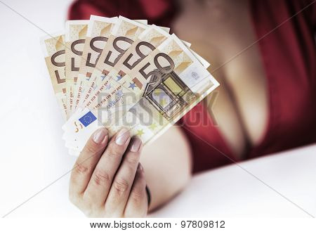 girl with large breasts shows banknotes earned