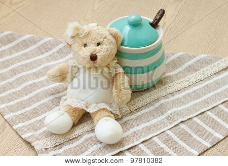Green pastel porcelain jar and little bear doll.