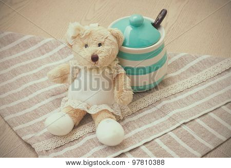 Green pastel porcelain jar and little bear doll in vintage style.