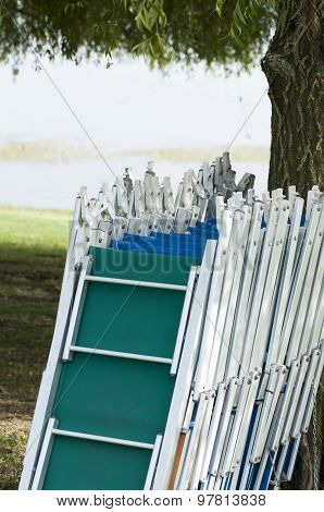 Empty Sunbeds In Line At The Lake