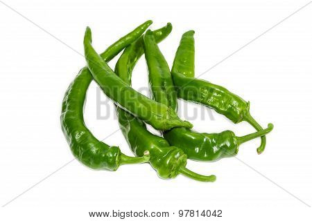 Several Green Peppers Chili On A Light Background