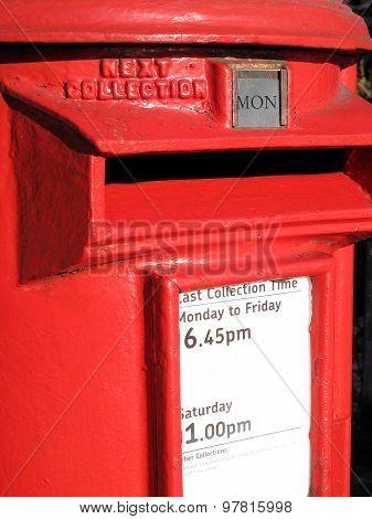 Red pillar post box