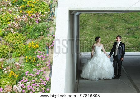Newlyweds Posing Under The Overpass