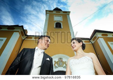 Newlyweds Posing In Front Of Lukavec Castle