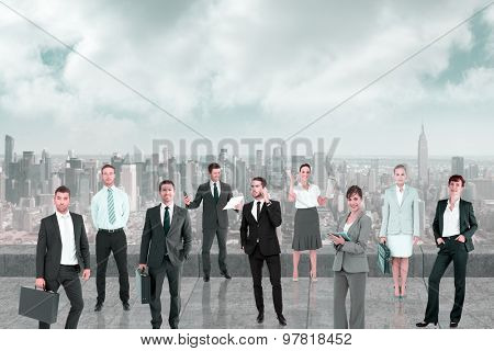 Business team against balcony overlooking city