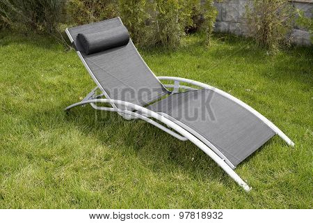 Advanced Deck Chair Over Green Grass In The Yard