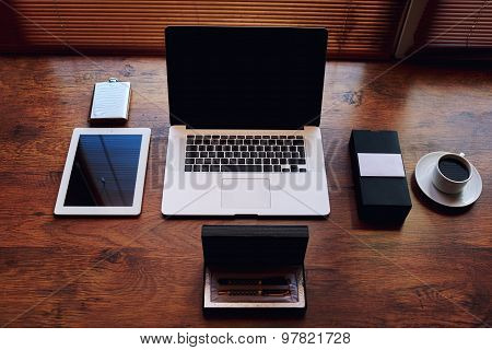 ?omputer and digital tablet with blank copy space screen in private office table of wealthy person