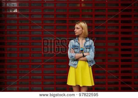 Charming young woman standing on blank copy space background for your text message or content