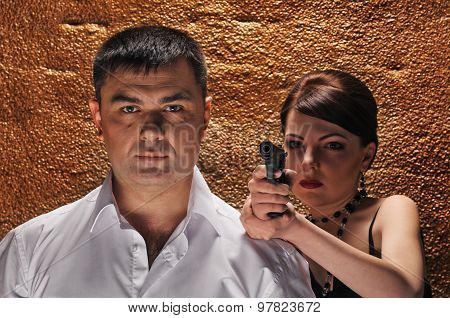 woman with gun protecting her man
