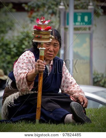 Tibetan Woman with Prayer Wheel