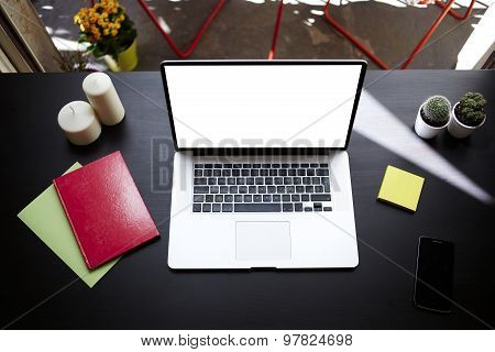 Laptop computer with blank copy space screen for your information or content on modern table
