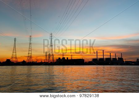 Electric power plant at sunrise with electric pole
