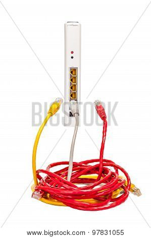 Three multicolored network cables and router on a white background
