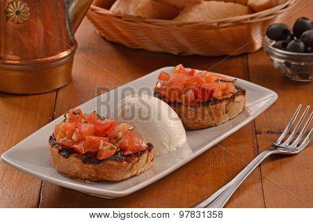 Bruschetta  and mozzarella cheese dish.bruschetta with tomato and mozzarella cheese ball.