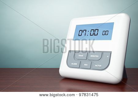 Old Style Photo. Digital Alarm Clock With Lcd Display