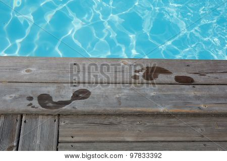 Wet Human Footprints On Dark Wooden Plank Floor