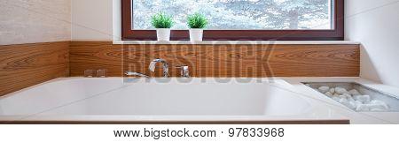 Big Bathtub With Ceramic Backsplash