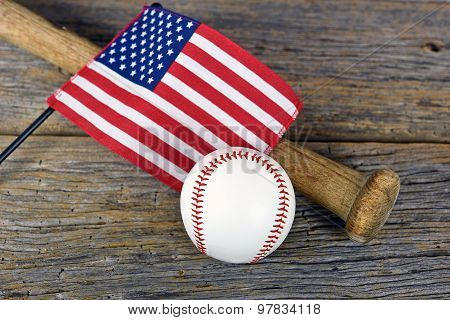 American flag with baseball and bat