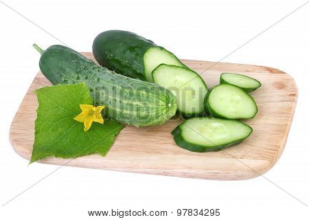 cucumber on cutting board isolated on white