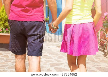 Romantic couple walking together and holding hands