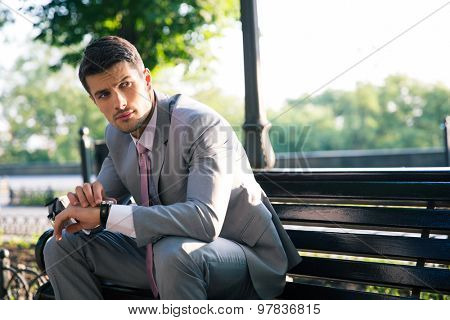Portrait of a businessman waiting for somebody outdoors