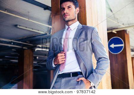 Portrait of a pensive businessman standing in underground parking
