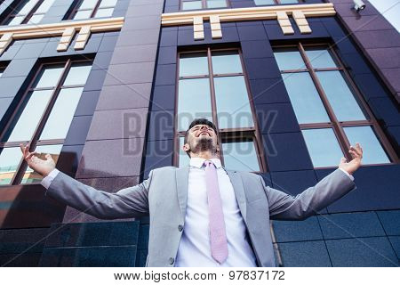 Excited businessman celebrating his success outdoors