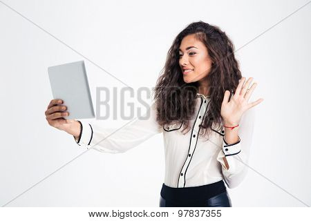 Happy businesswoman making video chat on tablet computer isolated on a white background