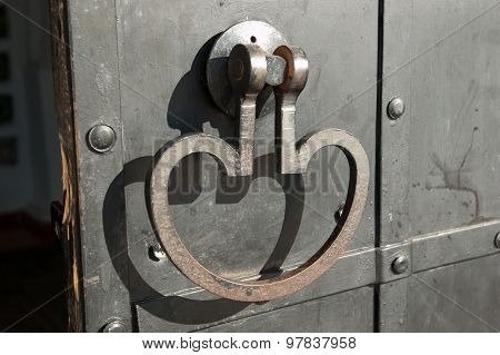 Detail of the door, door handle forged Verkhoturye bell tower of the Kremlin, Russia, Northern Urals