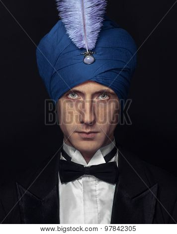 Illusionist - Middle-aged Man In A Turban, White Shirt With A Bow Tie
