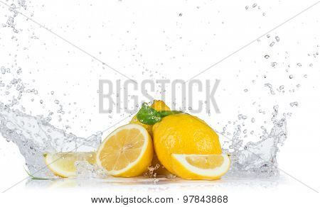 Fresh lemons with water splashes